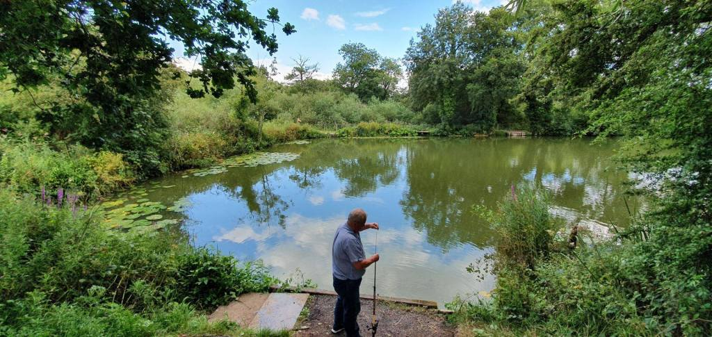 A lone angler at Perry Street Pond.